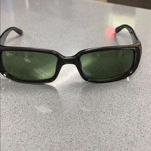 Black Gucci sunglasses.